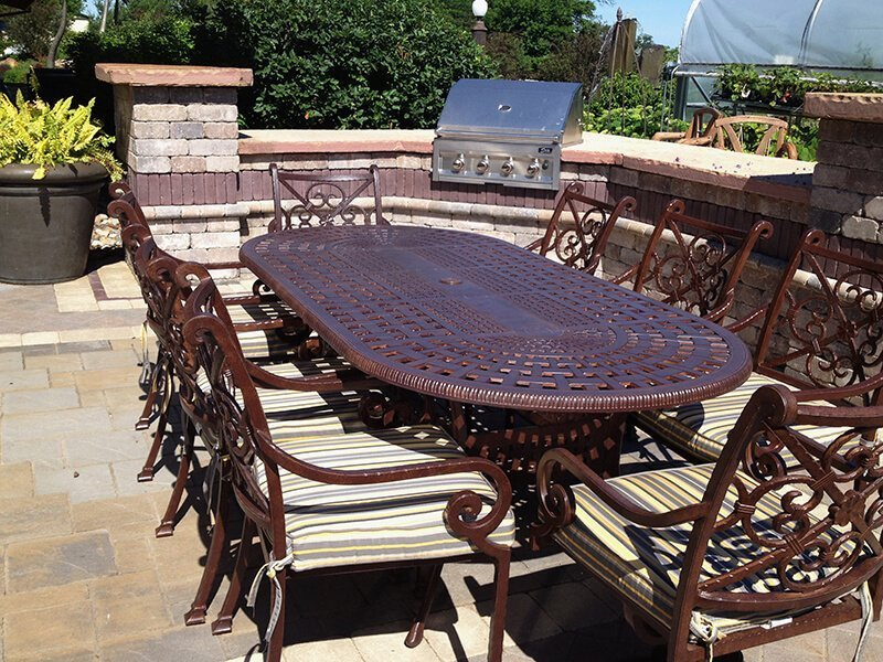 Outdoor Dining Set on Cement Patio and Outdoor Kitchen Grill
