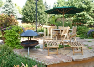Wood Outdoor Furniture on Large Stone Paver Patio