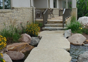 Large Stone Slab pathway and creek Backyard Landscaping