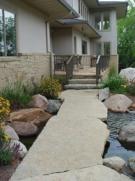 Large Stone Slab pathway and creek Backyard Landscaping