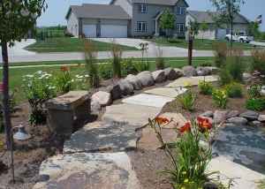 Stone Slab Pathway and pond Landscaping in Des Moines