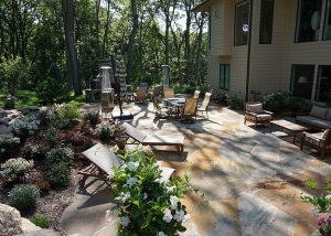 Large Stone Slab Patio and Outdoor Fireplace