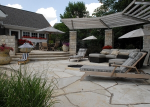 Large Stone Slab Patio and Firepit Landscaping by Ted Lare Des Moines