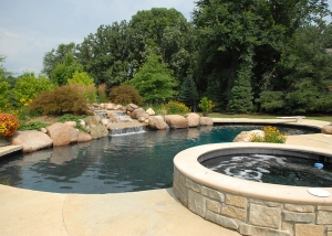 Outdoor Stone Hot tub and outdoor waterfall pool