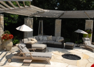 Outdoor Lounge Area with Firepit and Stone Patio