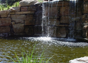 Waterfall Feature Stone Slabs and Boulder in Backyard Landscaping