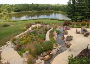 Country Living Outdoor Patio with Boulders and Creek