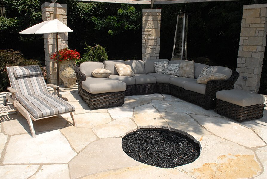 Beautiful Outdoor Fire Pit, Lounger and Sofa Landscaping by Ted Lare