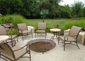 Simple Outdoor Fire Pit and Furniture on Stone Slab Patio