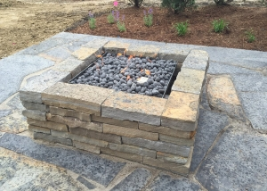 Raised Rock Outdoor Firepit on Stone Slab Patio