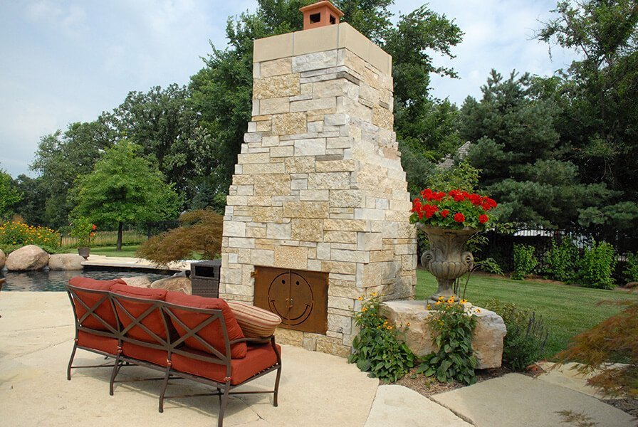 Outdoor Fireplace and Chimney on Stone Patio