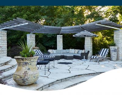 columns patio stone design rock retaining wall seating campfire backyard pool
